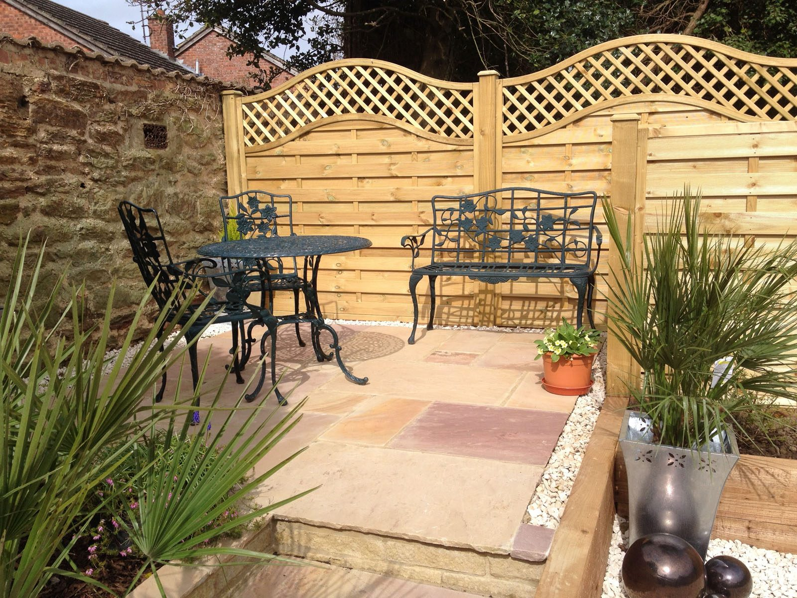 custom patio and fencing for outdoor coffee area