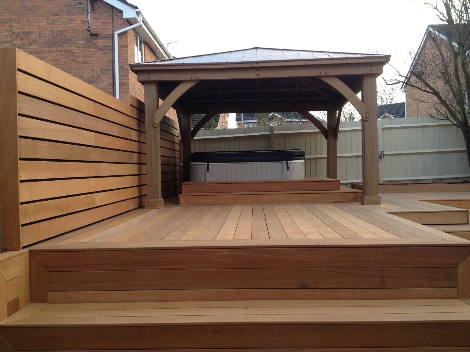custom design decking for Hottub by JTU with oak pavilion