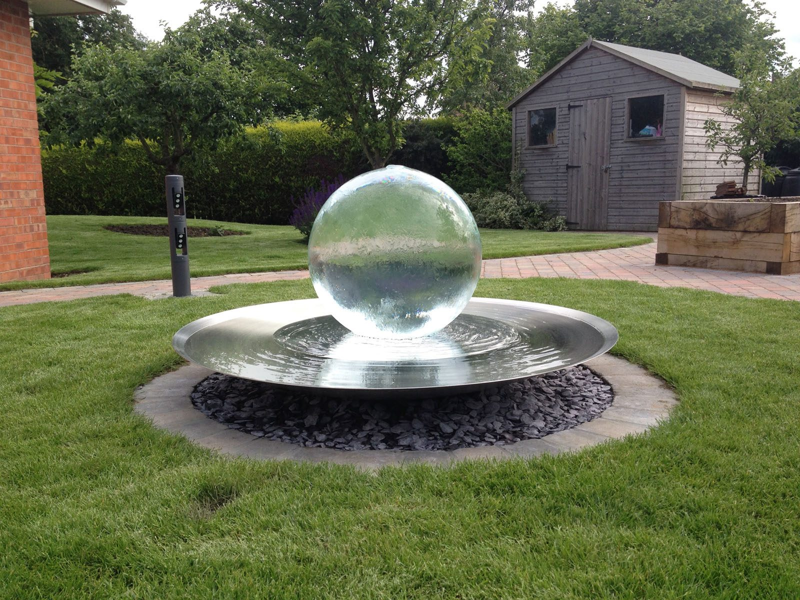 Bespoke spherical water feature and custom landscaping
